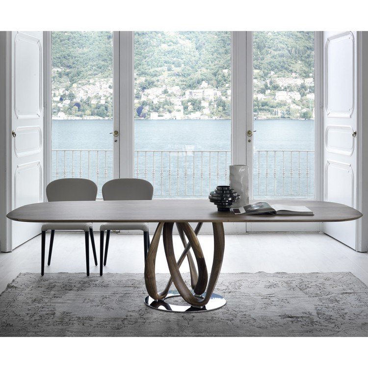 Infinity Wood dining table from Porada, designed by S. Bigi