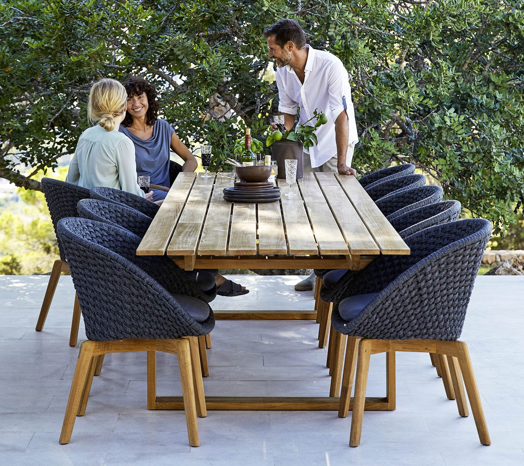 Endless Dining Table from Cane-line, designed by Foersom & Hiort-Lorenzen MDD