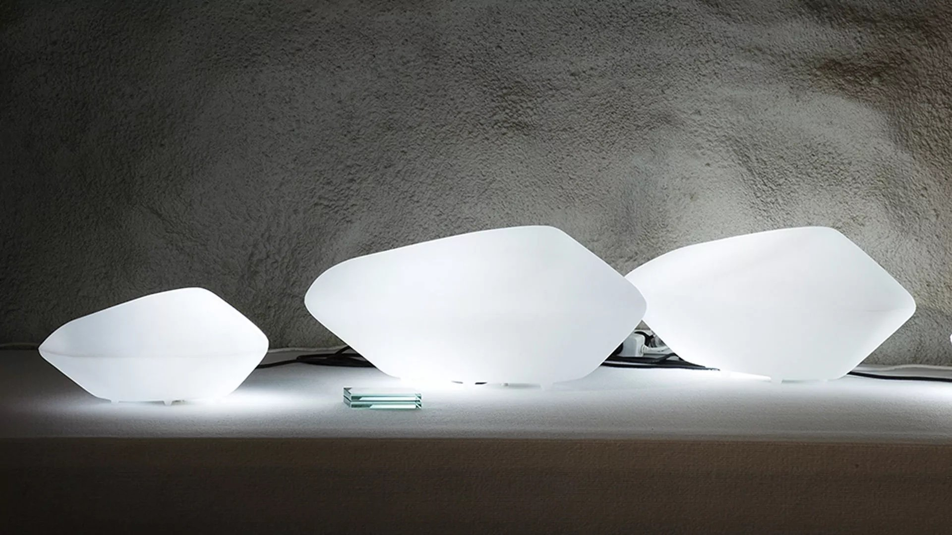 Stone of Glass Lamp lighting from Oluce, designed by Marta Laudani and Marco Romanelli